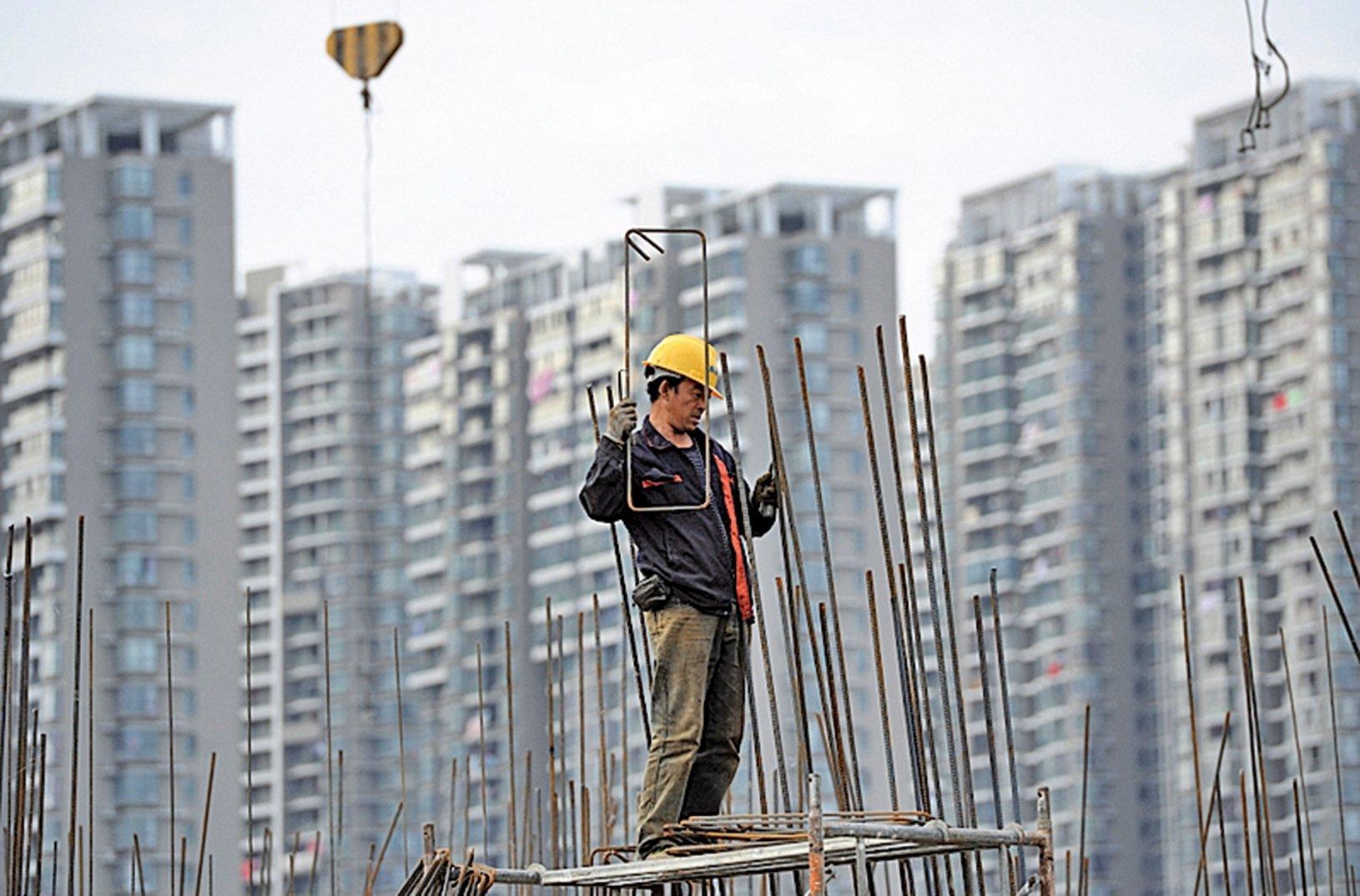 中國樓市被中共搾取了大半資金,同時也將中共因腐敗、低效、冗員所產生的巨大債務,通過高樓價轉移給了買樓的中國人。 (Getty Images)