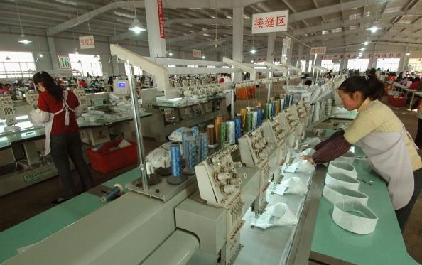 中國民營企業家們盼望民企和國企在中國不再有出身限制,都被一視同仁地成為「中國企業」。(AFP)