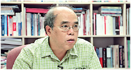 理工大學應用社會科學系助理教授鍾劍華,談到中共對大專院校的滲透打壓。(李逸/大紀元)