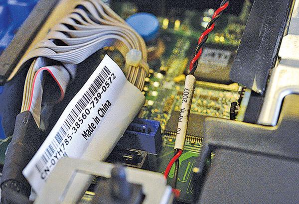 調查報告指,中共情報部門命令超微電腦(Supermicro)在服務器主板植入惡意晶片。(AFP)