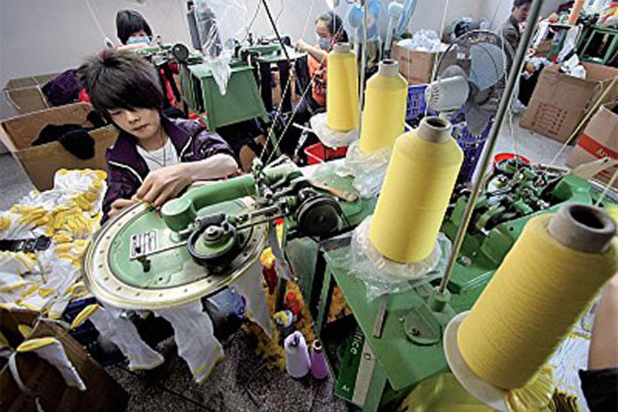 中國民營企業家們盼望民企和國企在中國不再有出身限制,都被一視同仁地稱為「中國企業」。(AFP)
