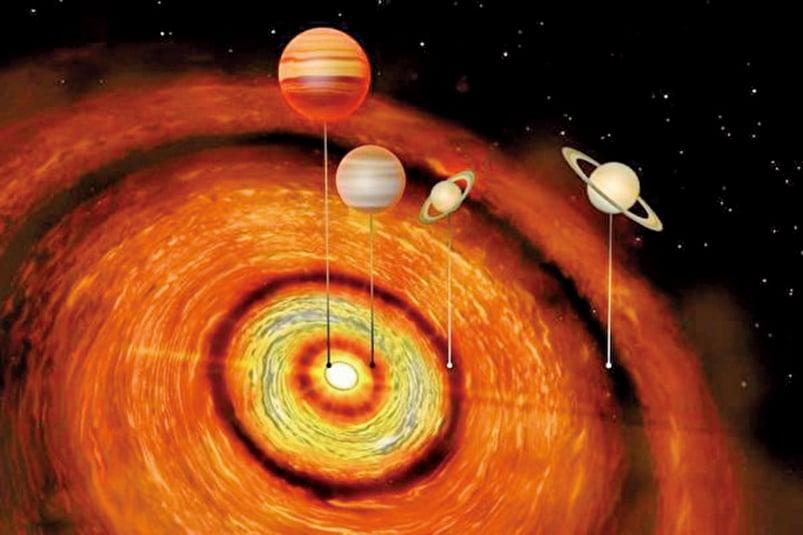 英國劍橋大學科學家首度發現,一顆年輕恆星有4顆巨大行星繞行。(University of Cambridge)