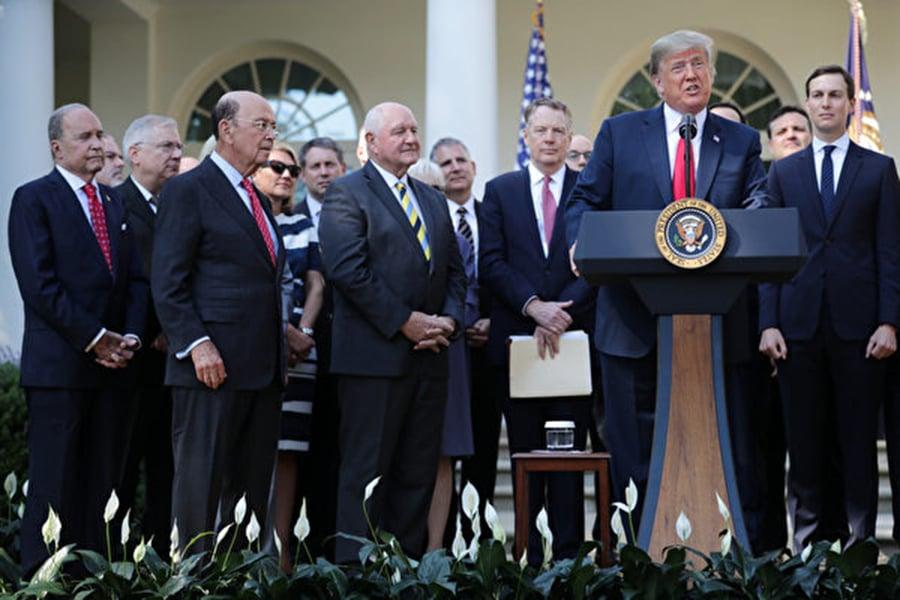 一股抵制中共影響的風潮在美國的帶領下正在全球掀起。圖為10月1日美國總統特朗普在記者會說明納入了多條防堵中共的「毒丸」條款的美加墨新自貿協定(USMCA)。 (Chip Somodevilla/Getty Images)