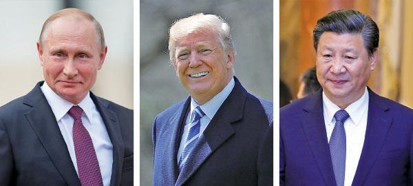 特朗普(中)下月將分別會見普京(左)和習近平(右)。(AFP)