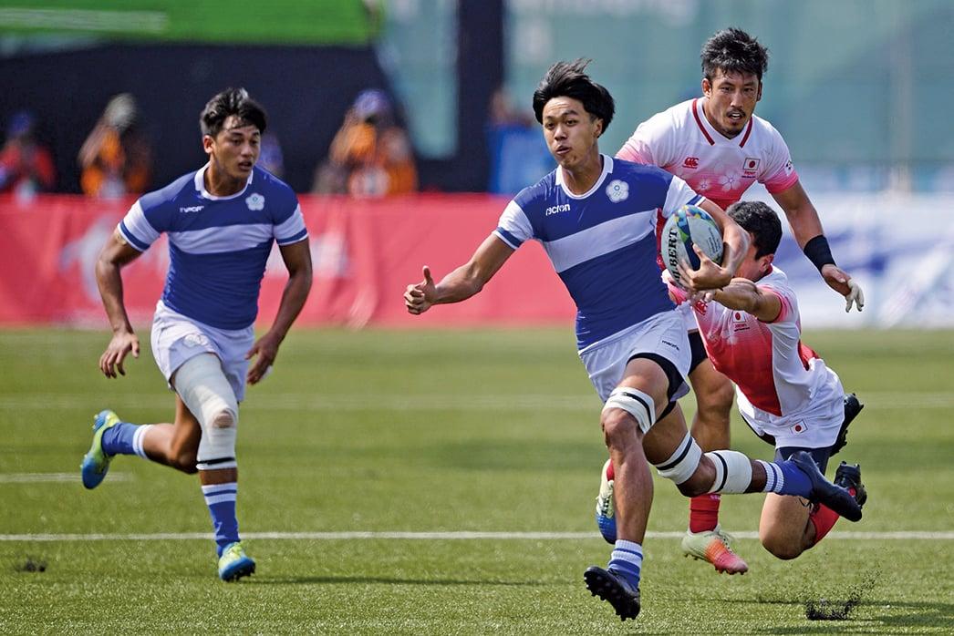 中共打壓台灣無所不用其極,連台灣要舉辦橄球賽都加以阻攔。圖為2018年8月31日,台日橄球選手在亞運會上競技。(Getty Images)