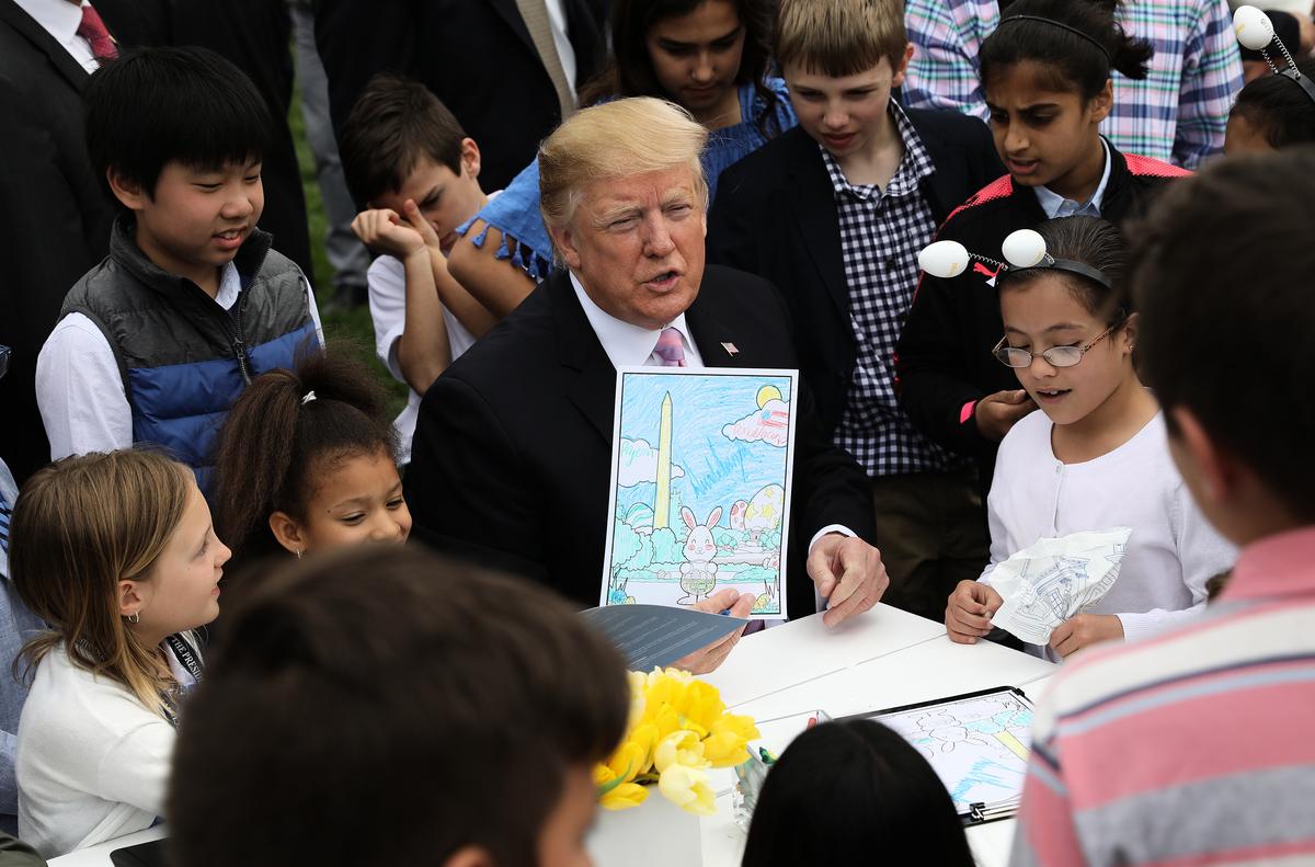在美國總統特朗普2016年競選期間擔任攝影師的金‧何(Gene Ho)說特朗普善良親切、尊重他人。(Win McNamee/Getty Images)