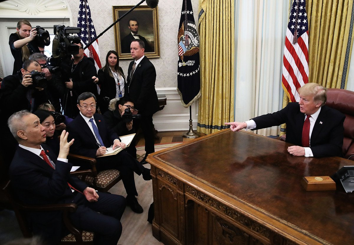 特朗普發動貿易戰,催促中共經濟改革,被認為將帶動中國政治與社會巨變。(Mark Wilson/Getty Images)