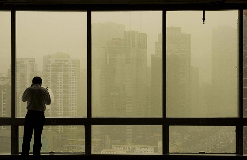 今年前三季度,北京市寫字樓市場繼續下行,成交放緩,空置率增加,租金下跌。 (STR/AFP/Getty Images)