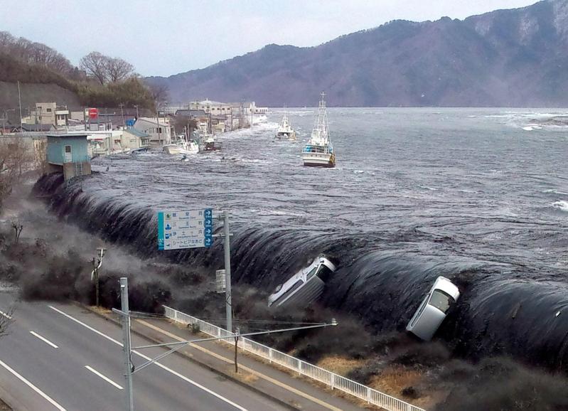 2011年3月發生的東京大地震,引發的巨大海嘯及福島核電站洩露。(JIJI PRESS/AFP ImageForum)