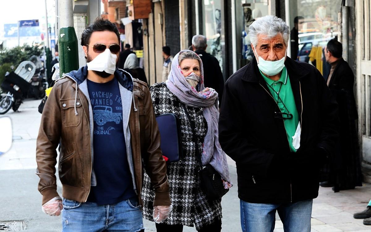 圖為2020年2月29日,在中共肺炎疫情籠罩下的伊朗街頭。(ATTA KENARE/AFP)