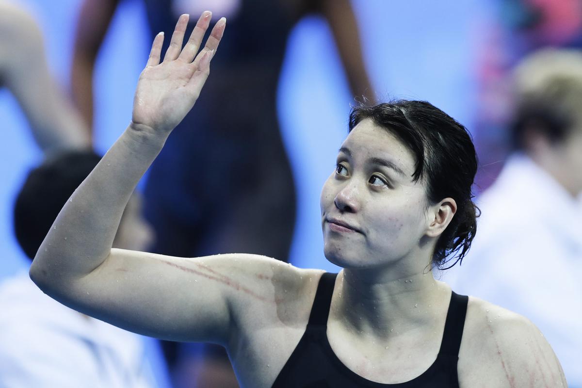 中國多個體育項目比賽要求選手參加體能測試,排名靠後者不得進入決賽。這一規定導致多名世界冠軍級選手落選,圖為游泳世界冠軍傅園慧資料圖。 (Photo by Fred Lee/Getty Images)