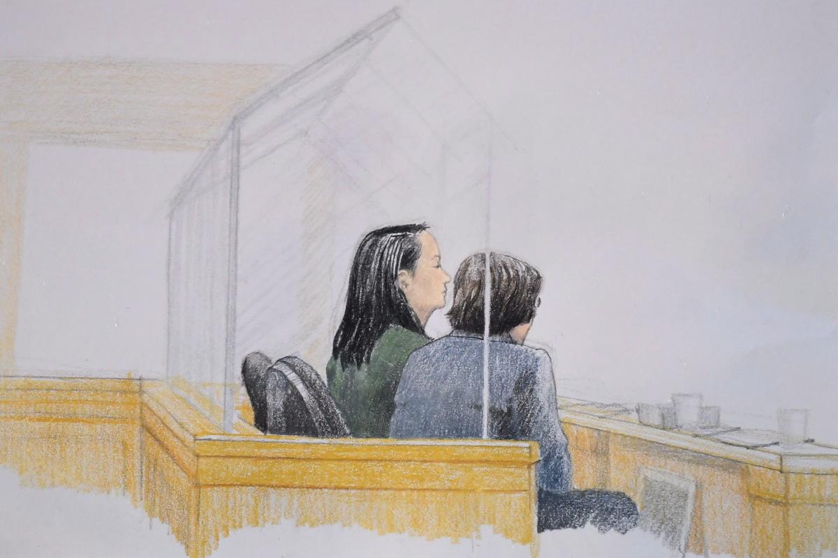 12月10日,孟晚舟(左)在卑詩高等法院接受保釋聆訊。圖右為翻譯。(加通社)