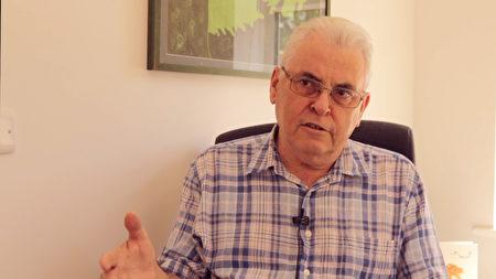 在中國被囚禁兩年的前英國記者、調查員漢弗萊(Peter Humphrey)在英國接受新唐人電視台採訪。(新唐人影片截圖)