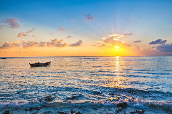 海上日出。 圖為示意圖。(fotolia)