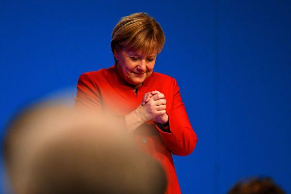 12月6日,默克爾再次當選為基民盟主席。(STOLLARZ/AFP/Getty Images)