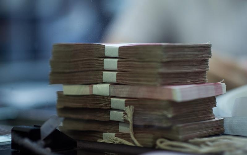 中共央行降準,釋放五千五百億以抗疫。(JOHANNES EISELE/AFP/Getty Images)