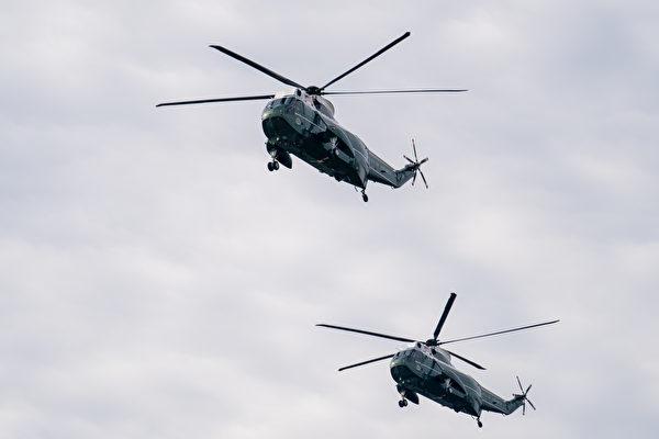 12月12日,數十萬來自美國各州的民眾聚集首都華盛頓DC,舉行盛大集會和遊行,要求「停止竊選(Stop The Steal)」,力挺特朗普總統。圖為特朗普總統乘坐直升機飛越舉行集會的自由廣場上方。(石青雲/大紀元)