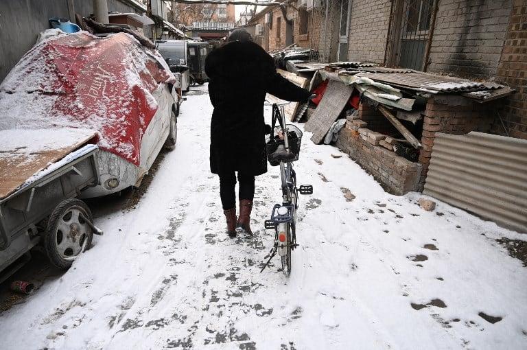 華北等北方地區將現今冬以來範圍最大、強度最強的一次降雪。圖為2019年2月12日的北京。(Photo by GREG BAKER / AFP)