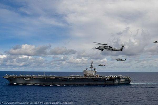 圖為美國尼米茲號航空母艦打擊群(USS Nimitz Carrier Strike Force)於7月6日在南中國海。尼米茲號航空母艦打擊群7月份同印度海軍舉行了演習。(U.S. Navy/Mass Communication Specialist 3rd Class Olivia Banmally Nichols)