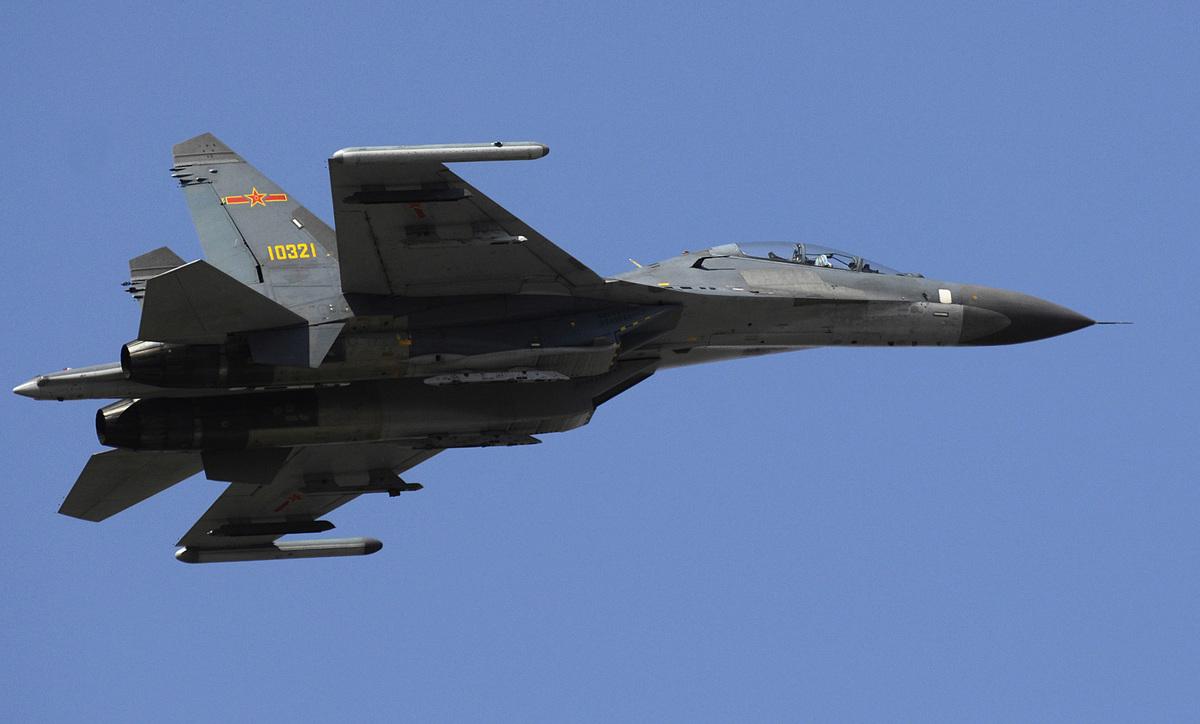 圖為中共殲11戰機。(維基百科公有領域)