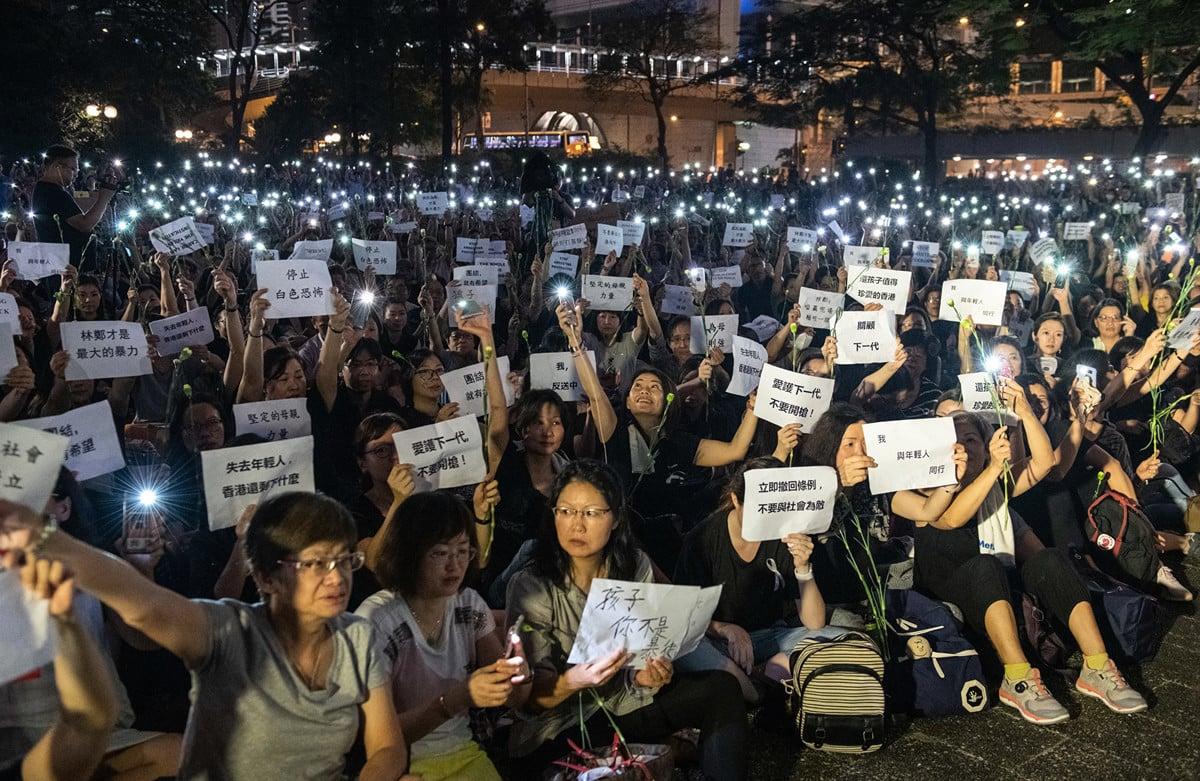 不論是香港反送中事件還是中美貿易戰,都是起因於對中共專制體系的不信任。 (Carl Court/Getty Images)