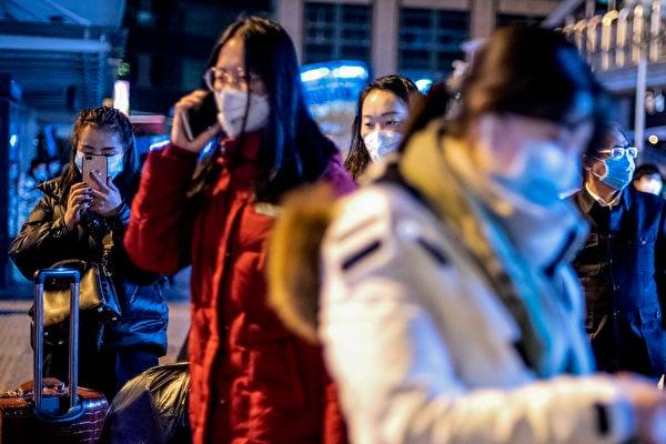 中共病毒迅速傳播,在中國感染了900多人。這種病毒如何傳播引發關注。(NOEL CELIS / AFP)
