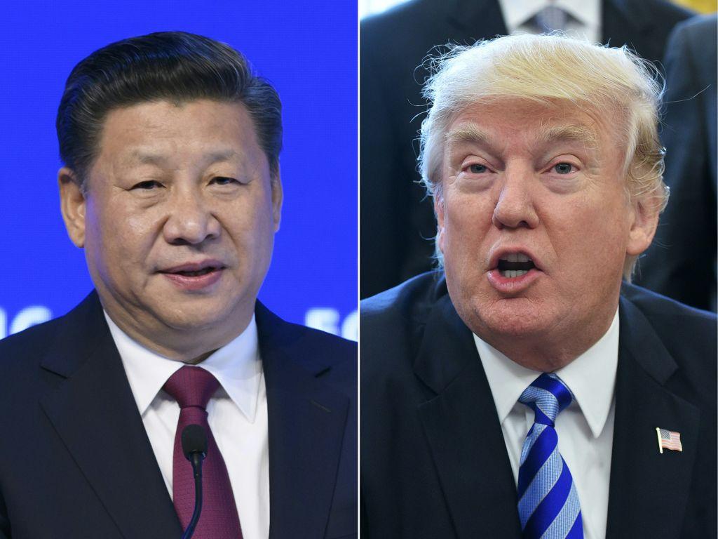 備受關注的「習特會」結束後,中共做出多個承諾後,美方承諾暫停提高關稅。(FABRICE COFFRINI,MANDEL NGAN/AFP/Getty Images)