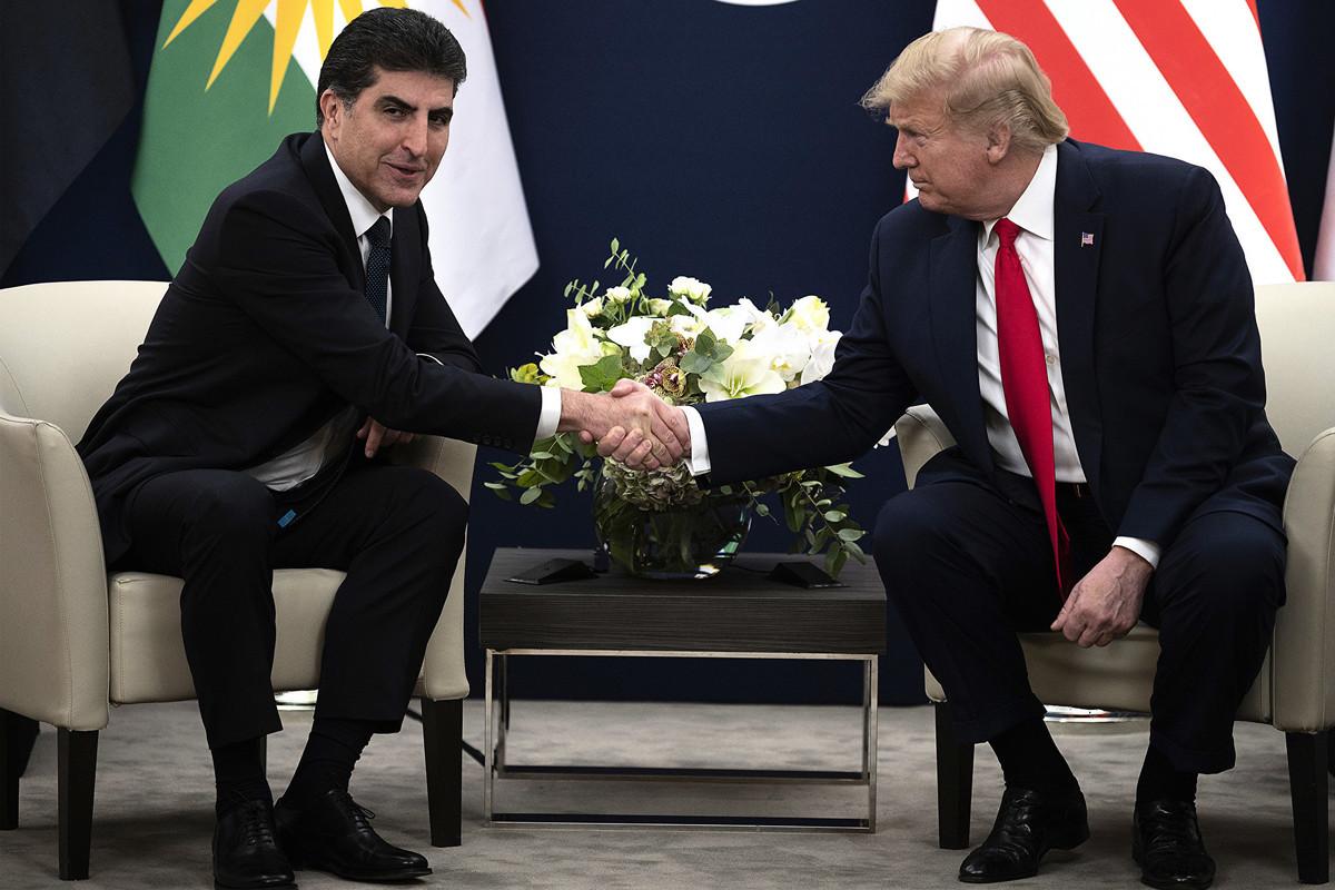 特朗普1月22日在達沃斯世界經濟論壇與伊拉克庫爾德總統納希爾萬‧巴爾扎尼(Nechirvan Barzani)會面期間,針對美國出現首例中共肺炎表示,美國針對新病毒已有計劃,美國會將其處理好。(JIM WATSON / AFP)