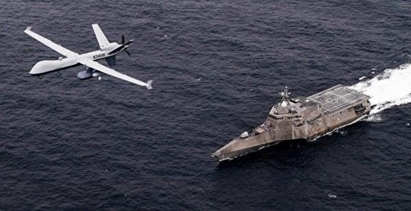 2021年4月21日,美軍的MQ-9無人機和獨立級濱海戰鬥艦科羅納多號(LCS 4)聯合演練。(美國海軍)