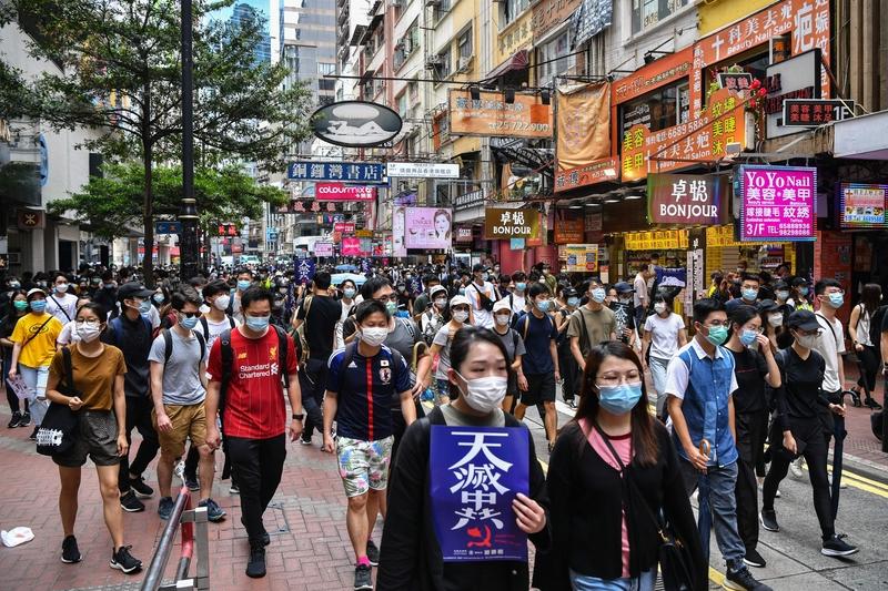 2020年5月24日,上萬香港人走上街頭,舉行反對「香港版國安法」大遊行。(ANTHONY WALLACE/AFP via Getty Images)