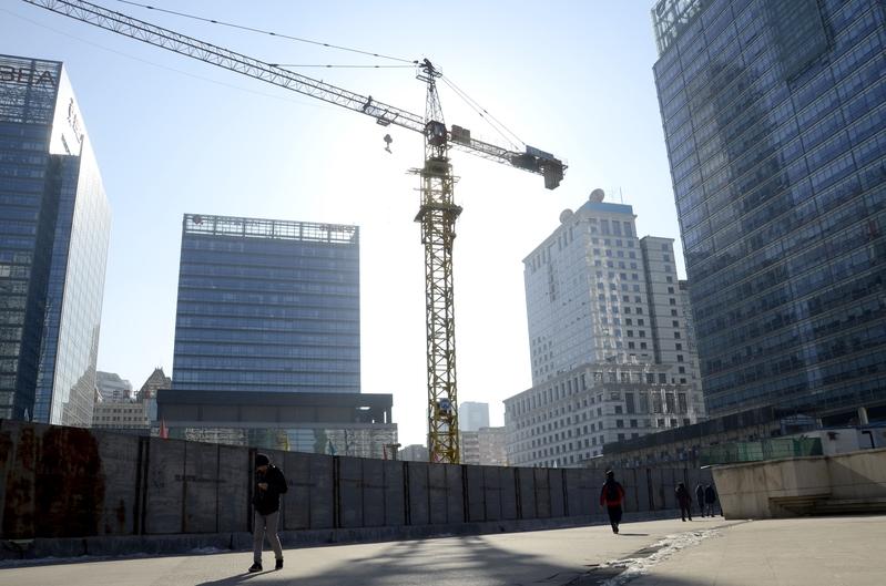 大陸房企綠地集團被催還債。圖為資料照。北京的一處工地。(WANG ZHAO/AFP)