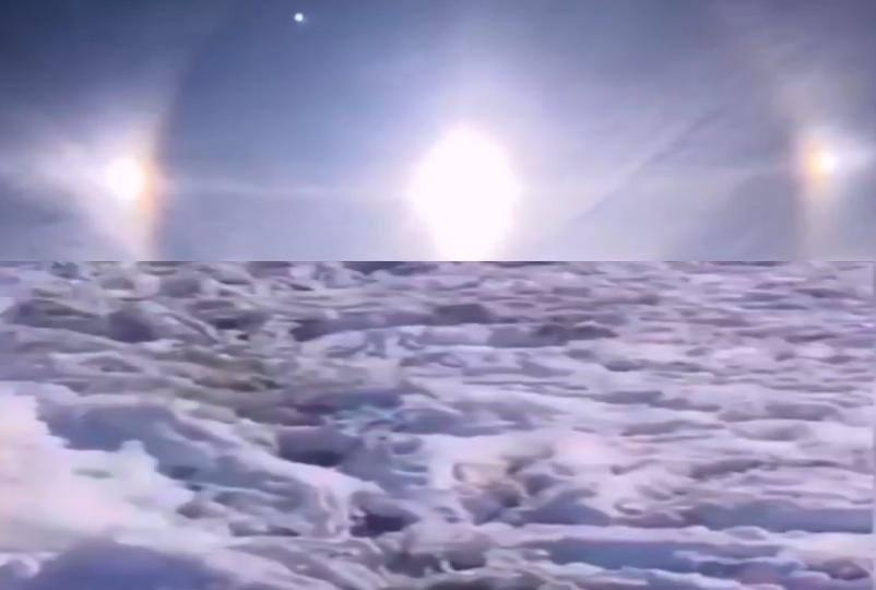 黑龍江大興安嶺地區漠河市天空出現三個太陽(上)。該省近日又降雪(下),把已經成熟的水稻壓趴在田里。(影片截圖合成)