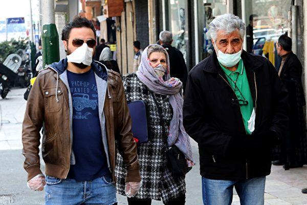 2020年2月29日,在中共肺炎疫情籠罩下的伊朗街頭。(ATTA KENARE/AFP)