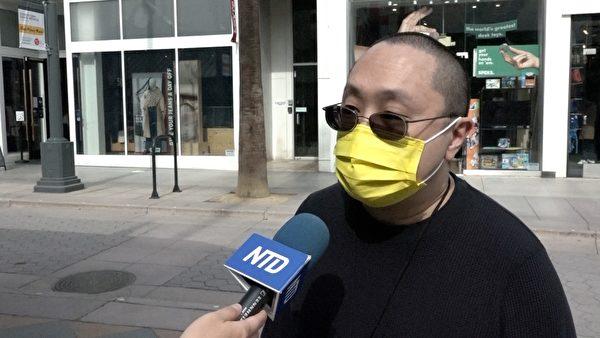 洛杉磯香港論壇成員林先生呼籲香港、北京政府儘快釋放47人。(新唐人電視台提供)