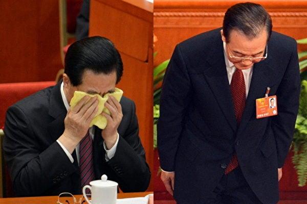 2013年3月,胡錦濤、溫家寶在中共「兩會」謝幕時的照片。(GOH CHAI HIN/AFP)