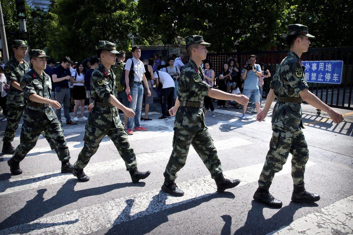 2018年7月26日,北京街頭的中國軍事警察。(加通社)