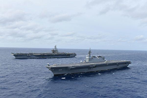 2019年6月11日,美軍航空母艦「列根號」(左)與日本海上自衛隊直升機護衛艦「出雲號」共同航行於南海。(U.S. Navy photo courtesy of JMSDF)