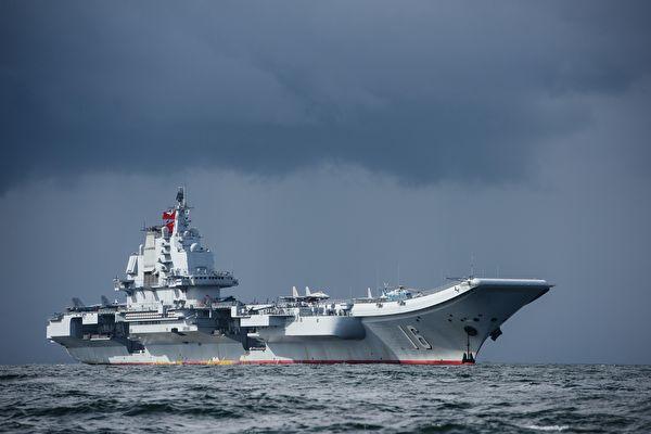 4月23日下午,中共海軍在青島舉行海上閱兵。令中共尷尬的是,整個閱兵活動在濃霧中結束。(AFP)