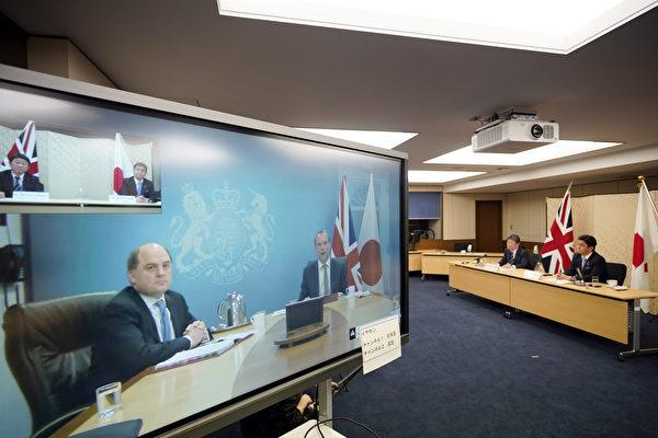 圖為2月3日,日本外相和防衛大臣與英國外相和國防大臣舉行「2+2」視訊會議。(Photo by FRANCK ROBICHON/POOL/AFP via Getty Images)