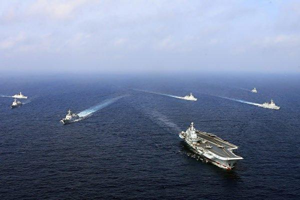 阿富汗變天後,中共大搞針對台灣的實兵軍演並挑撥美台關係。圖為中共軍艦。(AFP via Getty Images)