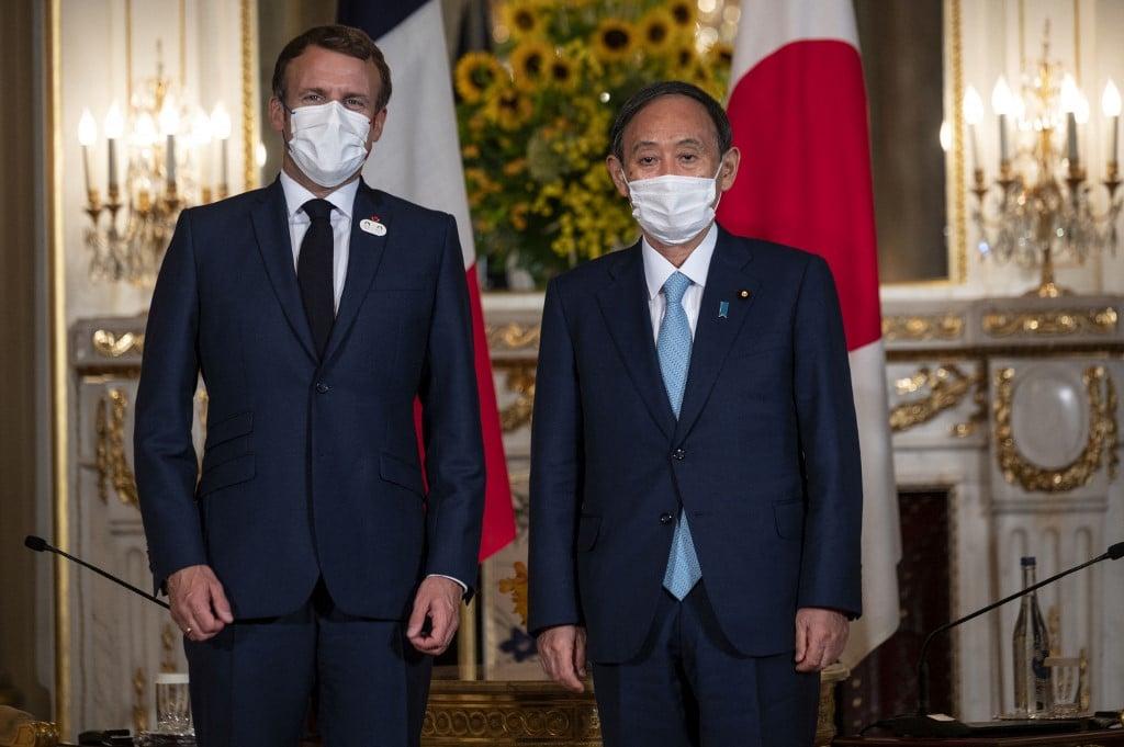 周六(7月24日),日本首相菅義偉和法國總統埃馬紐埃爾.馬克龍(Emmanuel Macron)在東京會晤,雙方同意加強安全關係,以實現一個自由開放的印太地區。 ( CHARLY TRIBALLEAU / AFP)