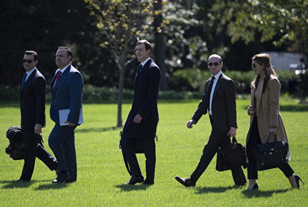 白宮官員們。(ANDREW CABALLERO-REYNOLDS/AFP)