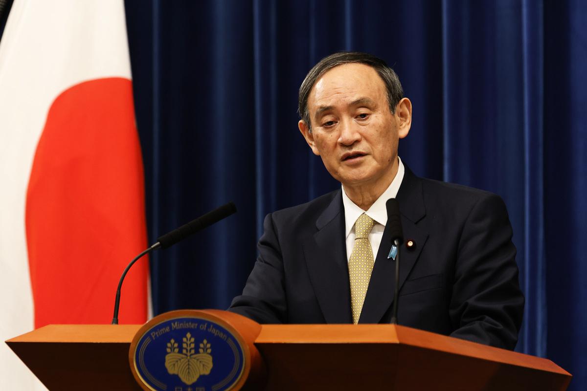 日本首相菅義偉2021年1月13日召開新聞會,宣佈更嚴格旅行限制措施。(RODRIGO REYES MARIN/POOL/AFP via Getty Images)
