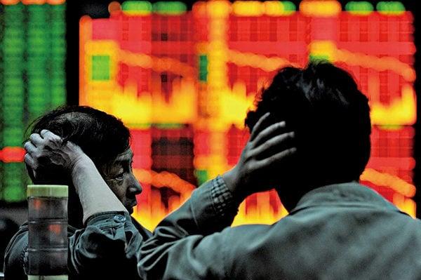 圖為大陸股市資料照。(AFP)