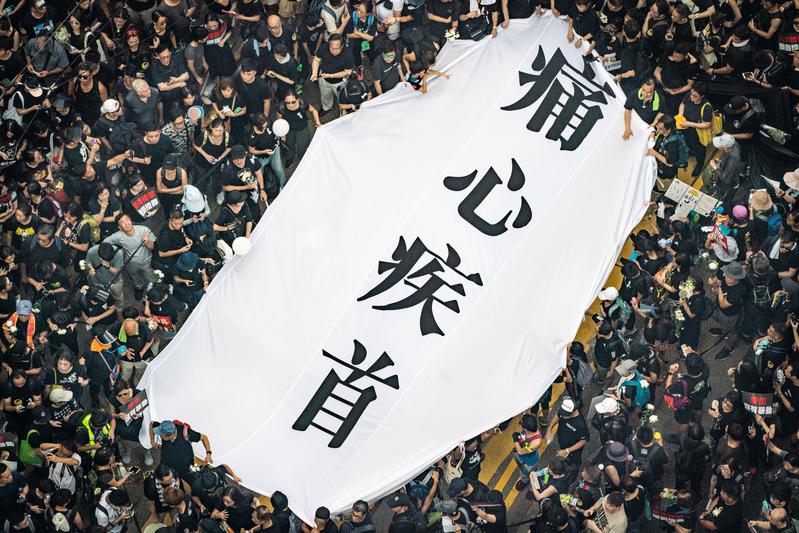 港府欲修訂《引渡條例》引爆200萬香港市民怒火,也點燃香港、台灣與國際社會新一輪反共潮。(Anthony Kwan/Getty Images)