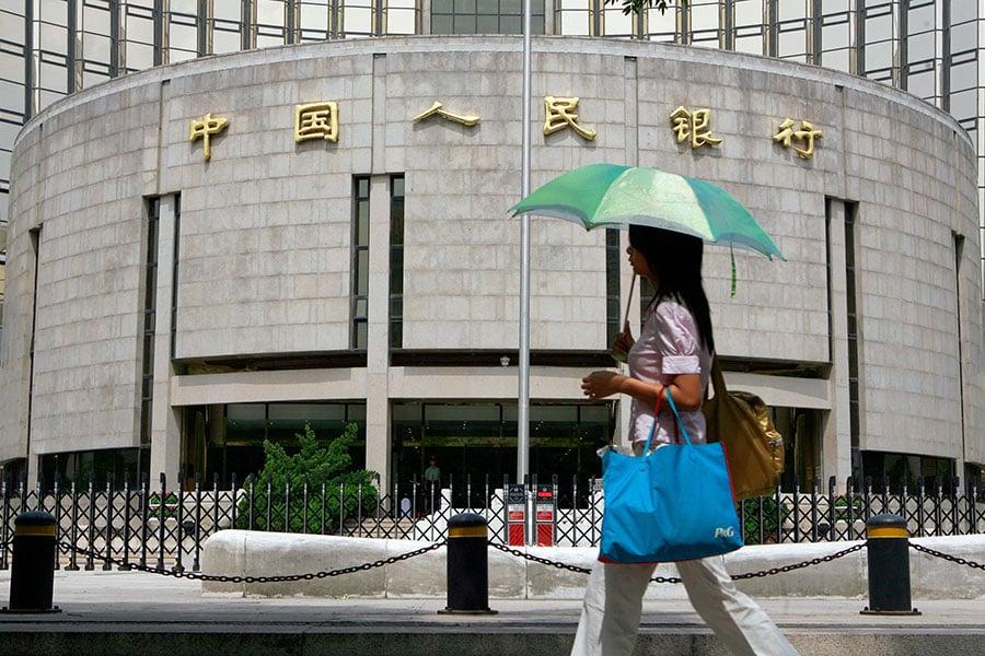 中共央行宣布,從9月16日開始,下調金融機構存款準備金率0.5%,這是中共央行今年第3次降準。(TEH ENG KOON/AFP/Getty Image)