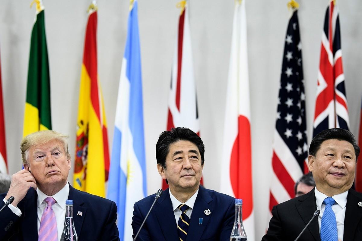 美國總統特朗普和中國國家主席習近平在日本G20峰會期間的會晤上,同意貿易戰暫時停火;特朗普表示,將允許美國企業向華為出售高科技設備,華為問題要留到談判最後再討論。(BRENDAN SMIALOWSKI/AFP/Getty Images)