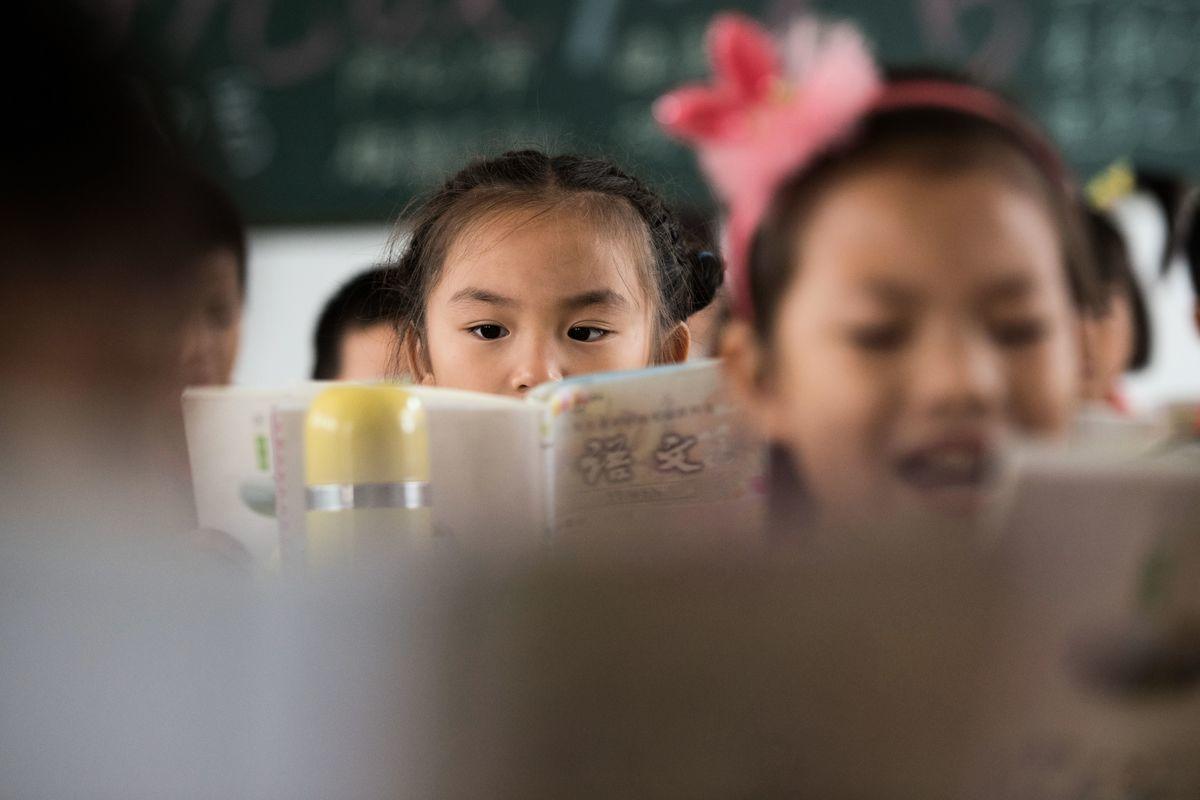 中共各級地方政府被指虛報入學人數、套取貪污國家教育經費。(JOHANNES EISELE/AFP/Getty Images)