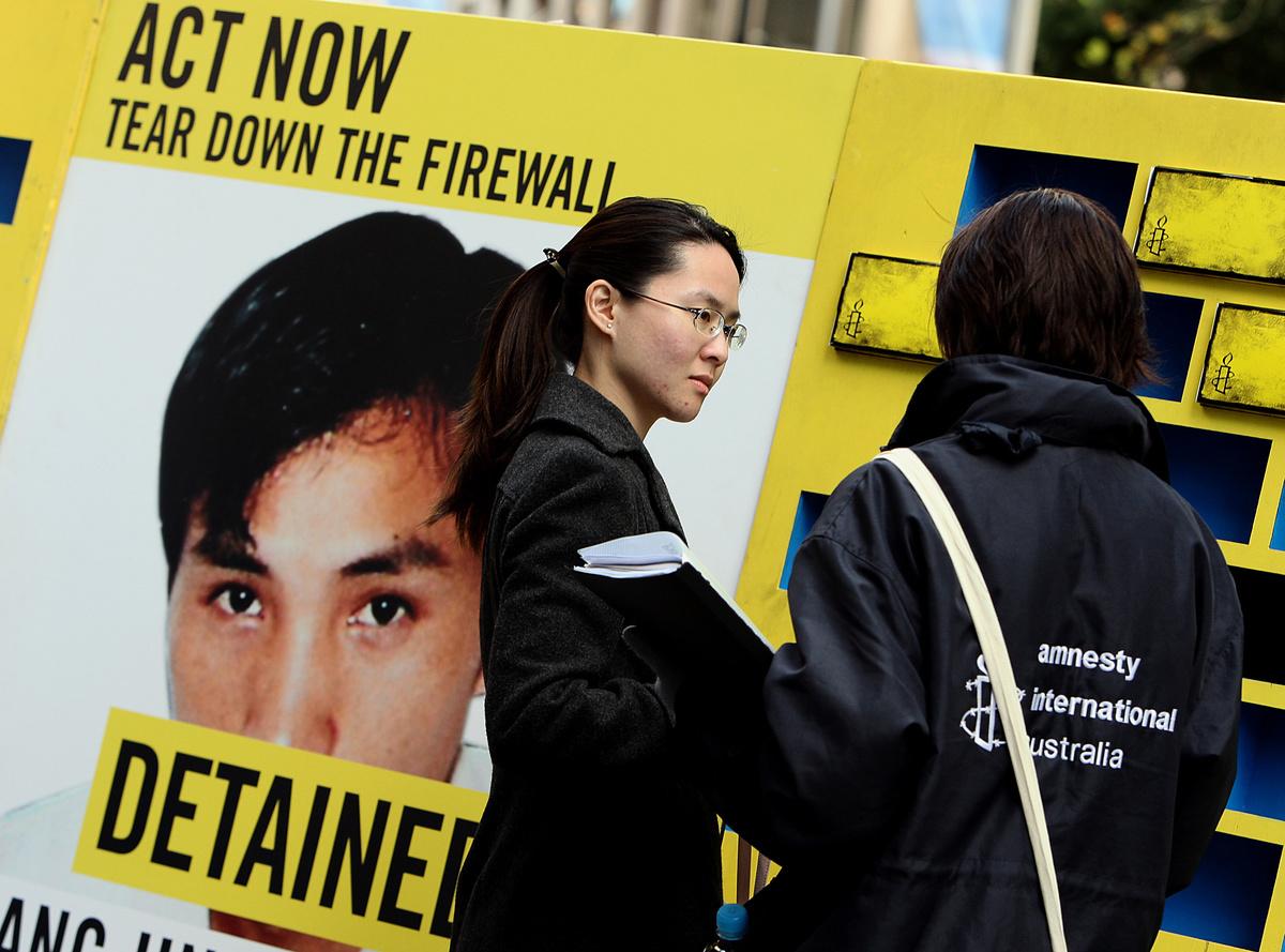 防火長城有效地封閉了中國及愚化人民。因此,推倒防火長城應該是美國在意識形態戰爭中打敗中國的關鍵。(GREG WOOD/AFP/Getty Images)