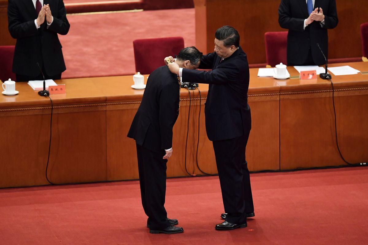 中國大陸的疫情仍然沒有退去,但中共當局8日就召開所謂的防疫「表彰大會」。(NICOLAS ASFOURI/AFP via Getty Images)